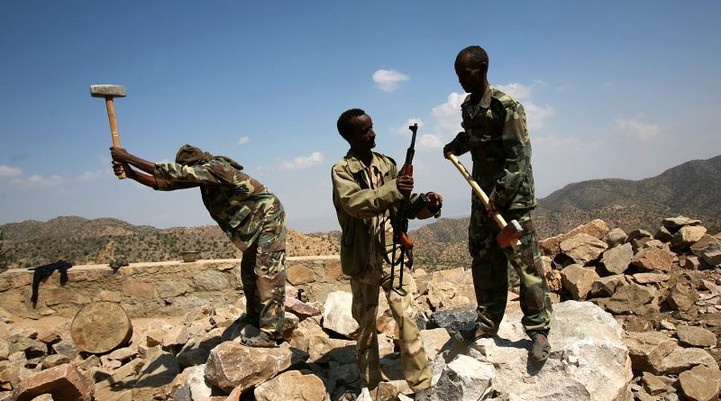 ASM145 - (Hold for story Eritrea by Jeffrey Gettleman) - Eritrean soldier break rocks while working on the construction of a road outside of Nakfah, Eritrea, Monday, October 8, 2007. Nakfah was a center for the EPLF's resistance movement against Ethiopia.  (Shawn Baldwin for the New York Times)